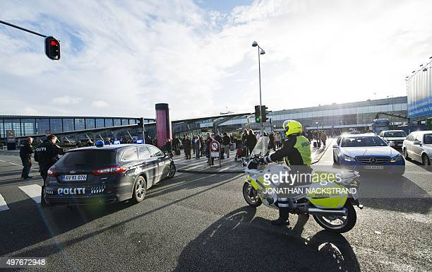 Police stand in front of terminal 3 at Kastrup airport in Copenhagen on November 18 2015 Danish police evacuated one of two terminals at Copenhagen's...