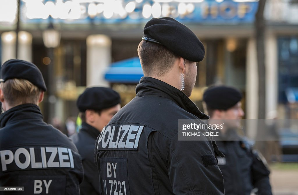 Police stand in front of the Bayerischer Hof hotel, the location for the 52nd Munich Security Conference (MSC), in Munich, southern Germany, on February 11, 2016. The Munich Security Conference takes place from February 12 und until February 14, 2016. / AFP / THOMAS KIENZLE