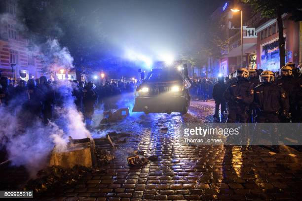Police stand in front of the Rote Flora leftwing centre after the 'Welcome to Hell' protest march on July 6 2017 in Hamburg Germany Leaders of the...