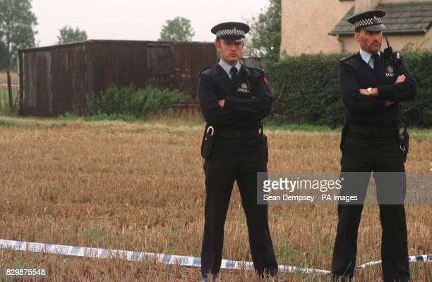 Police stand in front of the shed where Margaret Jarvis and her two son's Christopher and Russell were discovered in a with a hose pipe leading from...
