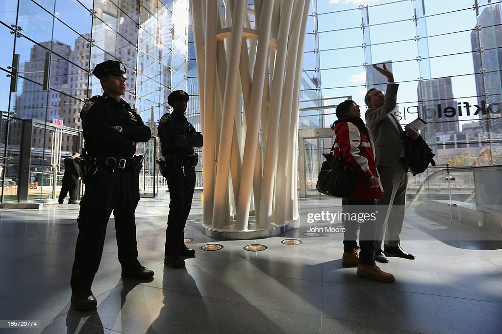 Police stand in the Brookfield Place Pavilion at the newly-opened World Trade Center West Concourse pedestrian transit connection on October 24, 2013 in New York City. The underground corridor links the World Trade Center PATH Station on the east end of the concourse to Brookfield Place Pavilion (formerly the World Financial Center), and the Battery Park City Ferry Terminal on the west end of the concourse. The 600-foot long marble corridor, designed by Spanish architect Santiago Calatrava and built by the Port Authority, is the first part of the World Trade Center Transportation Hub to open to the public.