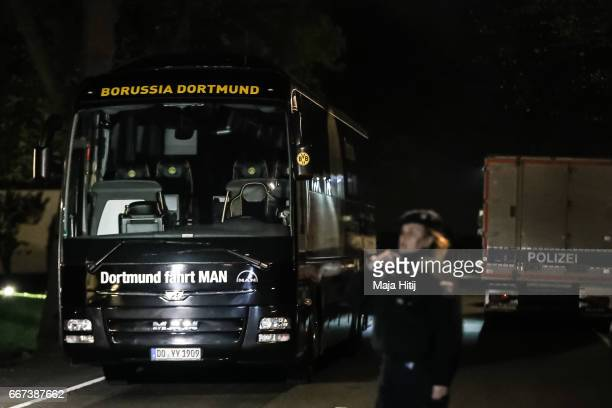 Police stand near team bus of the Borussia Dortmund football club after it was damaged in an explosion on April 12 2017 in Dortmund Germany According...
