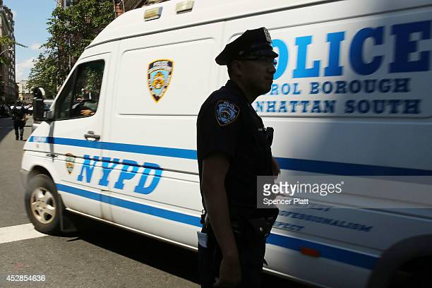 Police stand near where two US Marshals and one New York Police Department detective were shot in the afternoon along a quiet street on July 28 2014...