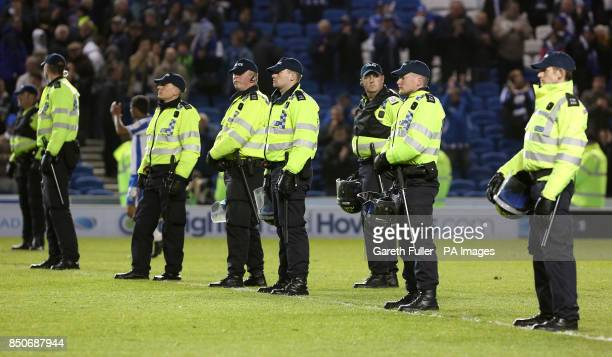 Police stand on the pitch after the final whistle