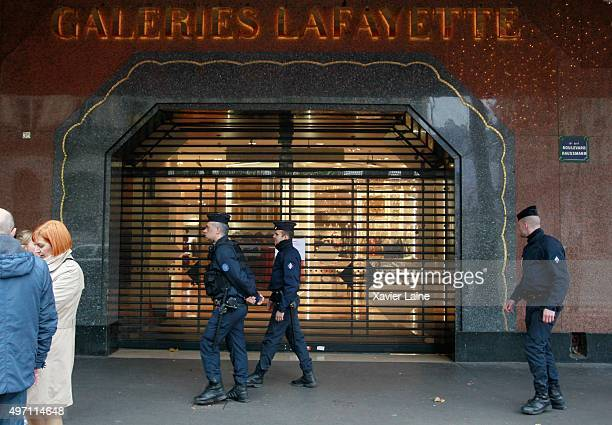 Police stand out in front of Galeries Lafayette Boulevard Haussman department store as its closed its door following a series of terrorist attacks in...