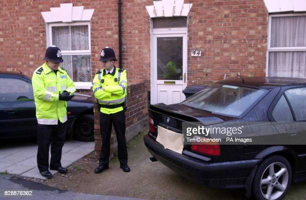 Police stand outside number 44 St James Street Gloucester the home of suspected al Qaida operative Sajid Badat Friday 28 November 2003 Neighbours...