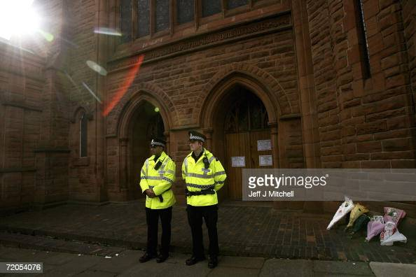 Police stand outside St Patricks Church in Glasgow where a womans body has been found September 30 2006 in Glsgow Scotland Police are expected to...