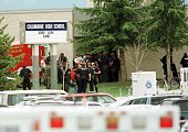 Police stand outside the east entrance of Columbine High shool as bomb squads and SWAT teams secure students 20 April 1999 in Littleton Colorado...
