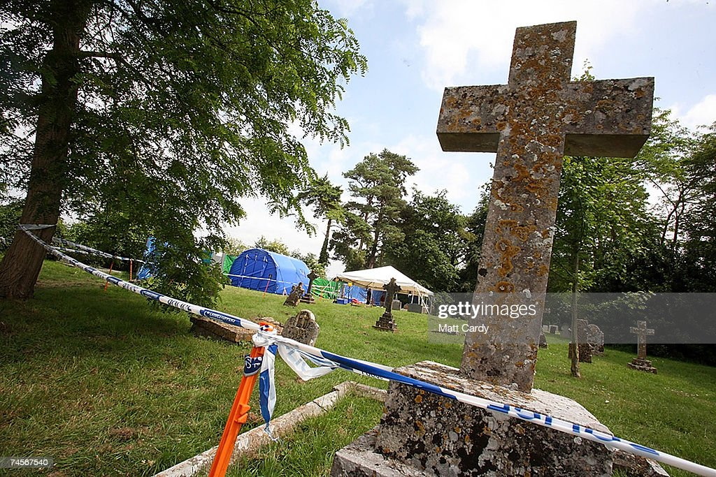 Police stand outside the gates to the church as they prepare to exhume the body of Marion Alder who died last July aged 79 at Parkfields Residential...