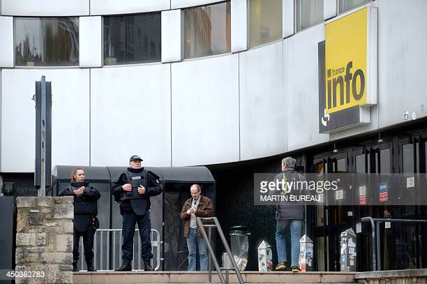 Police stand outside the headquarters of French radio station France Info in Paris on November 18 as a frantic manhunt is underway after a 27yearold...