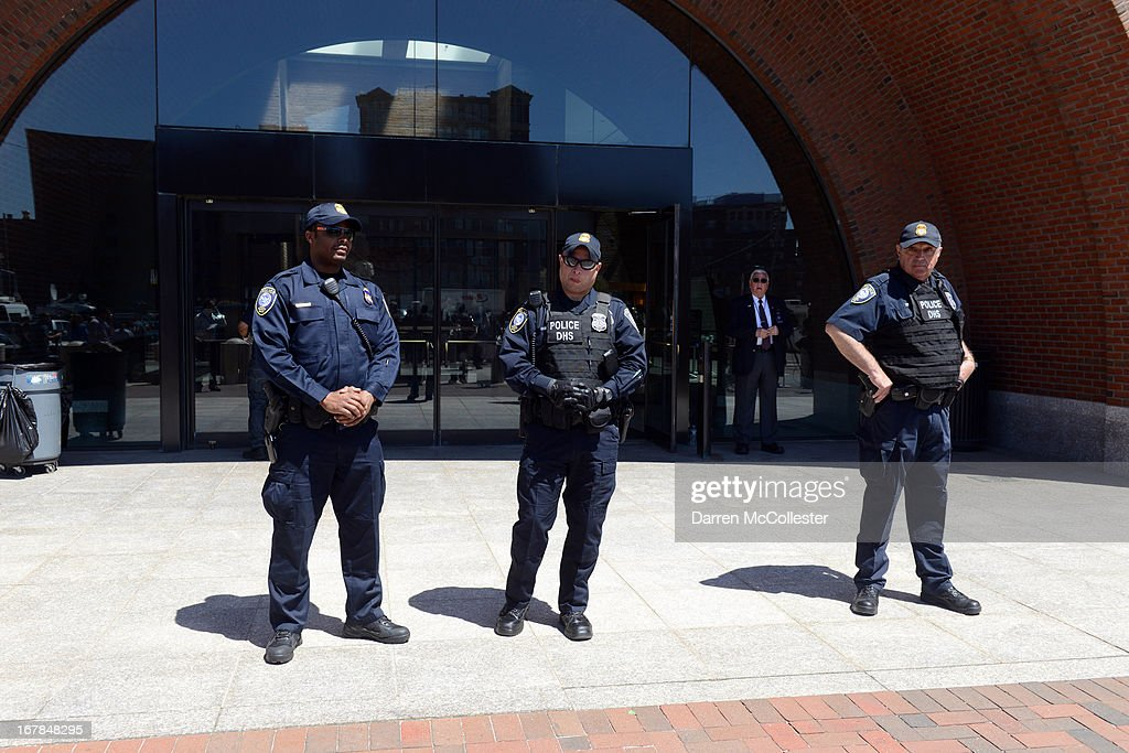 Police stand outside the John Joseph Moakley Courthouse after authorities arrested three men today in connection with the Boston Marathon bombings May 1, 2013 in Boston, Massachusetts. They are alleged to have helped the Tsarnaev brothers after the bombings. Two men, Azamat Tazhayakov and Dias Kadyrbayev, came to America to study at the University of Massachusetts at Dartmouth, where Dzhokhar Tsarnaev was also ernolled. The third person taken into custody is a U.S. citizen but was not identified.