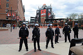 Police stand watch outside Oriole Park at Camden Yards before the game was postponed between the Baltimore Orioles and the Chicago White Sox on April...