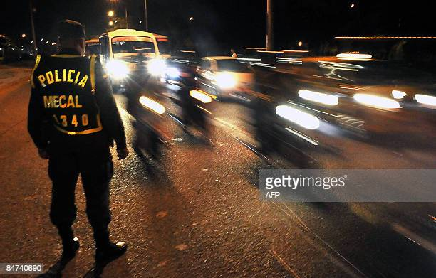 STORY A police stands guard in a street late at night on February 7 2009 in Cali 500 km southeast of Bogota department of Valle del Cauca Colombia...