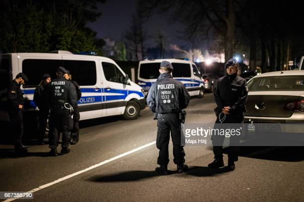 Police stands near the team hotel after bus of the Borussia Dortmund football club was damaged in an explosion on April 12 2017 in Dortmund Germany...