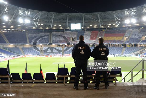 Police stands on the pitch of the HDI Arena after the friendly football match Germany vs the Netherlands was called off for 'security reasons' in...