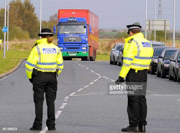 Police stop a private lorry driver driving for Royal Mail as it enters the NorthWest mail distribution centre in Warrington northwest England on...