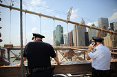 Police stop along the Brooklyn Bridge following the discovery of a pair of white flags that appeared overnight atop the two towers of the Brooklyn...