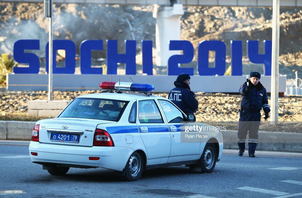 Police stop traffic lane near the Gorki Media Centre in the Rosa Khutor Moutain Cluster on February 5, 2014 in Sochi, Russia.