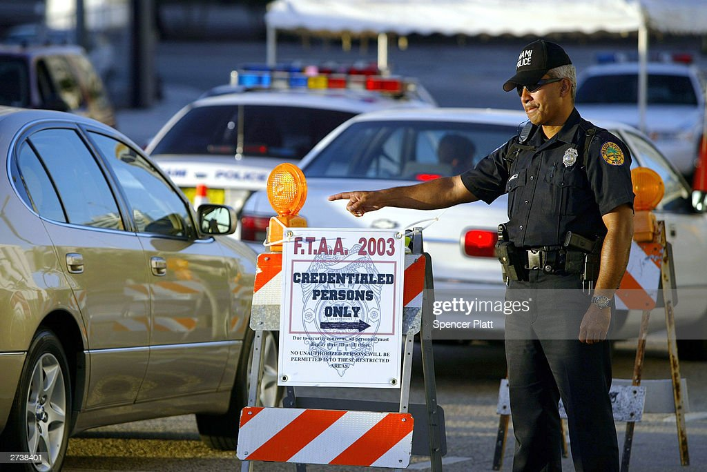 Police stop traffic on the first day of the 2003 round of ministerial negotiations for the Free Trade Area of the Americas (FTAA) November 17, 2003 in Miami, Florida. Due to expected protests from anarchists, labor groups and globalization foes, much of the city of Miami is in a police lockdown.