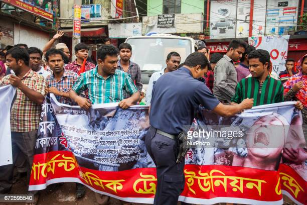Police stopping the activist to gather in front of the monument at the site where the building once stood in Savar on the outskirts of Dhaka on April...