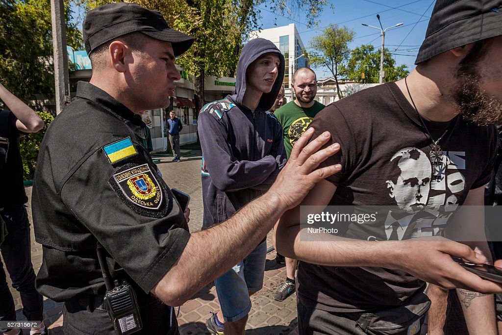 Police stops a group of people with a t-shirt of the ultranacionalist leader Stepan Bandera, when tried to provoke the prorussian crowd gathered in the entrance of the Kulikovo Pole square during the remembrance of the deaths in the Trade Unions House clashes in Odessa, southern Ukraine, on May 2, 2016.