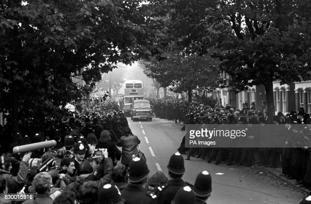Police struggle to hold back hundreds of pickets as a worker's bus approaches the Grunwick film processing plant in Willesden north London