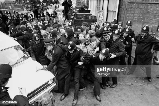 Police struggle to hold back pickets as a van enters the main gate of the troubled Grunwick film processing firm at Willesden in North London