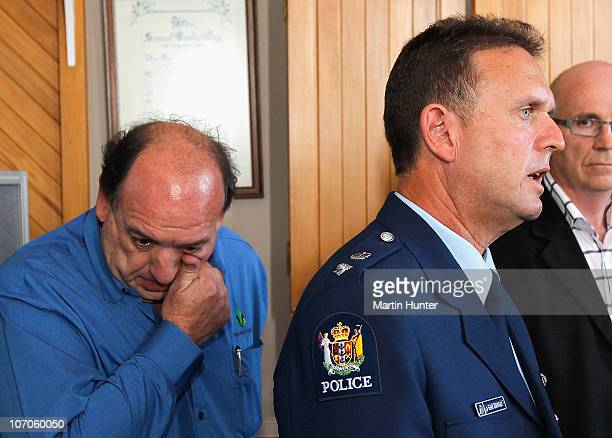 Police Superintendent Gary Knowles speaks to the media while CEO of Pike River Coal Mine Peter Whittall wipes his tears during a press conference on...