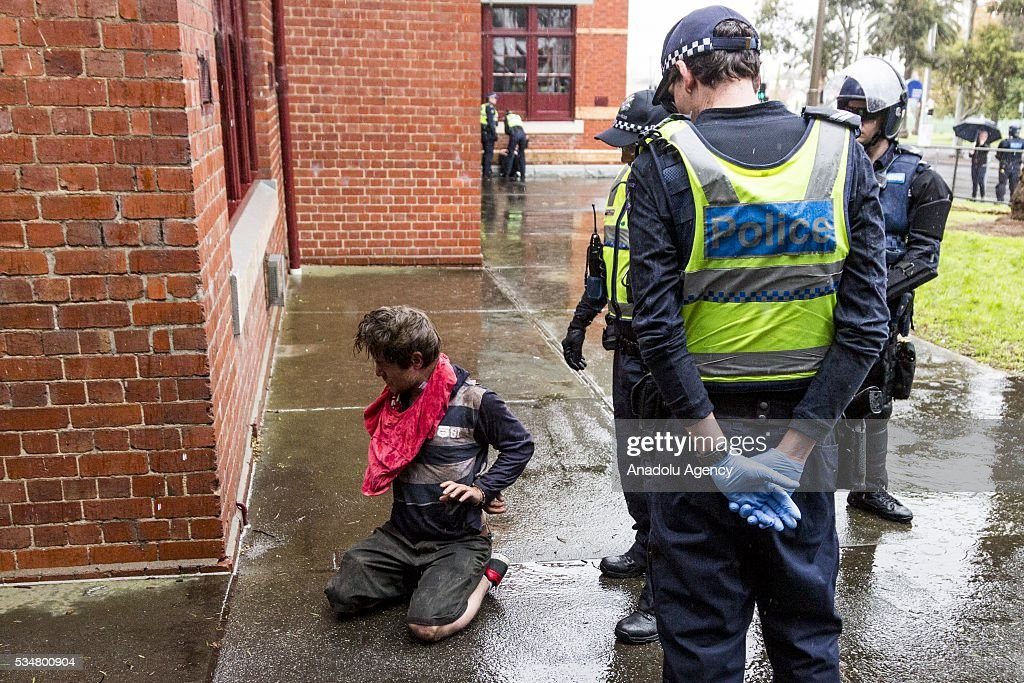 Police surround a handcuffed True Blue Crew member after he was pepper sprayed during a 'Say No To Racism' protest and a counter 'Stop the Far Left' rally in Coburg Melbourne, Australia on May 28, 2016. Seven men were arrested after a violent brawl erupted between rival protesters at an anti-racism rally in Melbourne's inner-north. Anti-Facists clashed with Anti-Islam nationalists who go by the name 'True Blue Crew'.