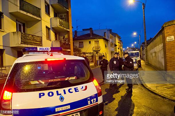 Police surround a property during an operation to arrest 23yearold Mohammed Merah 23 the man suspected of killing seven victims including three...