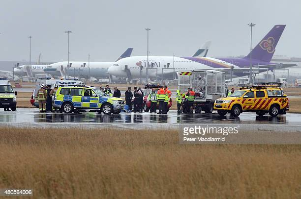 Police surround protestors occupying part of the northern runway at Heathrow Airport on July 13 2015 in London England The Plane Stupid action group...