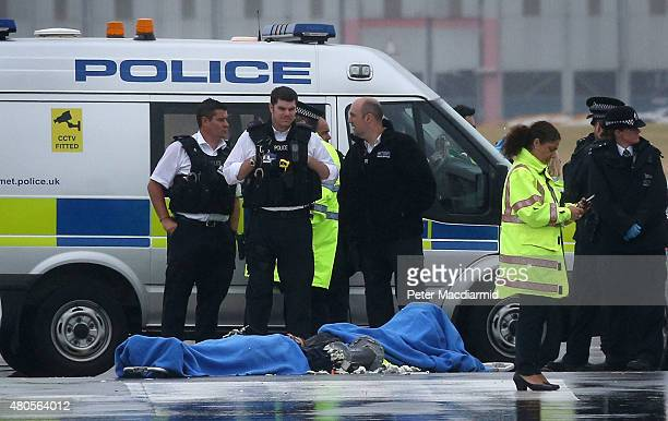 Police surround the last two remaining protestors occupying part of the northern runway at Heathrow Airport on July 13 2015 in London England The...