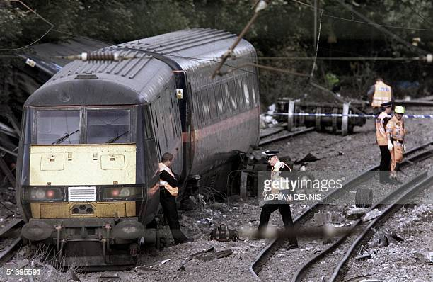 Police survey 17 October 2000 the tail end of a train which derailed just outside Hatfield 30 miles north of London The train travelling from London...