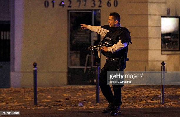 Police survey the area of Boulevard Baumarchais after an attack in the French capital on November 13 2015 in Paris France At least 18 people were...