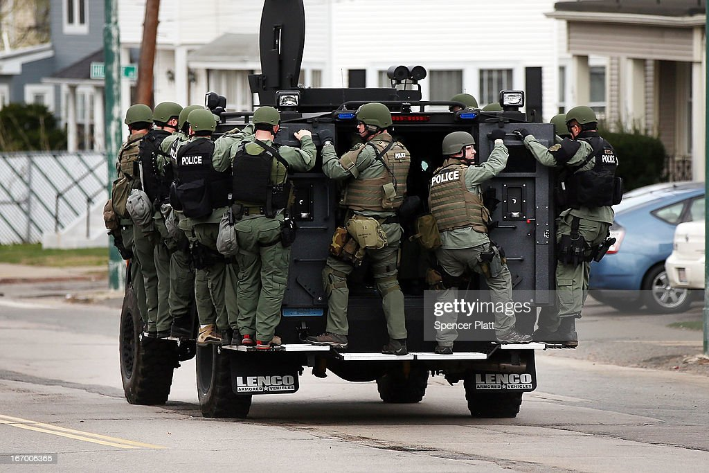 A police tactical unit drives through the streets as they search for 19-year-old bombing suspect Dzhokhar A. Tsarnaev on April 19, 2013 in Watertown, Massachusetts. After a car chase and shoot out with police, one suspect in the Boston Marathon bombing, Tamerlan Tsarnaev, 26, was shot and killed by police early morning April 19, and a manhunt is underway for his brother and second suspect, 19-year-old Dzhokhar A. Tsarnaev. The two men are suspects in the bombings at the Boston Marathon on April 15, that killed three people and wounded at least 170.