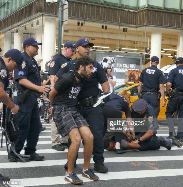 Police take a group of activists under custody during a protest in response to violence erupting at the white supremacist rally those organized by...