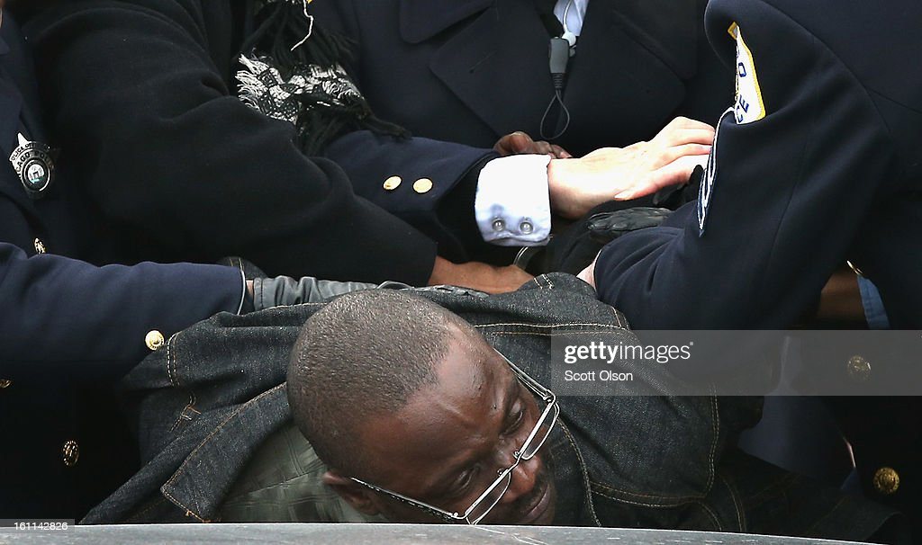Police take a man into custody outside the Greater Harvest M.B. Church before the start of a funeral for 15-year-old Hadiya Pendleton on February 9, 2013 in Chicago, Illinois. Hadiya was killed on January 29, when a gunman opened fire on her and some friends while they were standing under a shelter on a warm rainy afternoon in a park about a mile from President Obama's Chicago home. First lady Michelle Obama attended the funeral with Senior White House Adviser Valerie Jarrett and Secretary of Education Arne Duncan.