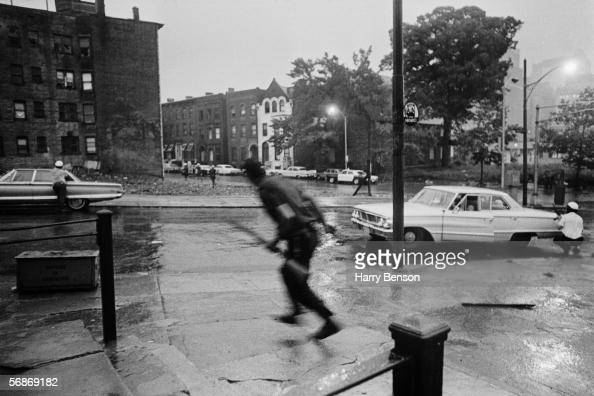 Police take cover behind parked cars during the riots in Newark New Jersey 14th July 1967 The disturbances began after a black taxi driver was...
