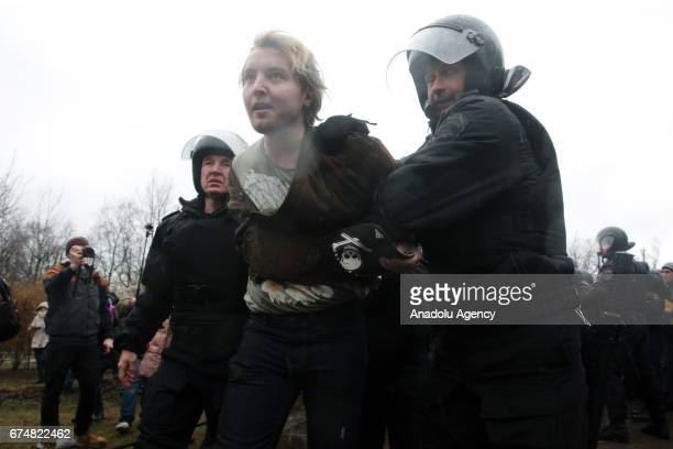 Police take protesters into custody during a rally that urging Vladimir Putin not to run for a fourth term for Presidential elections at Gorkovskaya...