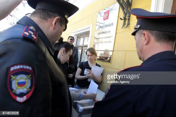 Police take protesters into custody during a rally that urging Vladimir Putin not to run for a fourth term for Presidential elections in Kazan Russia...