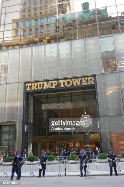 Police take security measure in front of the Trump Tower during a protest in response to violence erupting at the white supremacist rally those...