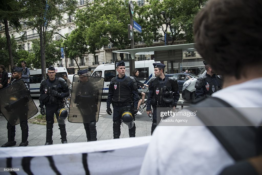 Police take security measurements as protesters gather to protest against the labour law in Paris, France on June 28, 2016. Country-wide protests and strikes, led by uniuons has been continuing for weeks.