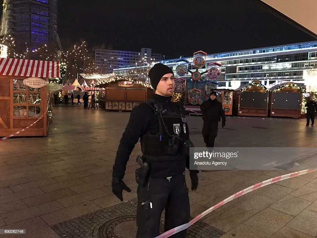 Police take security measures after a truck plough into a crowd at a Christmas market site in Berlin, Germany on December 19, 2016. Several injuries reported.