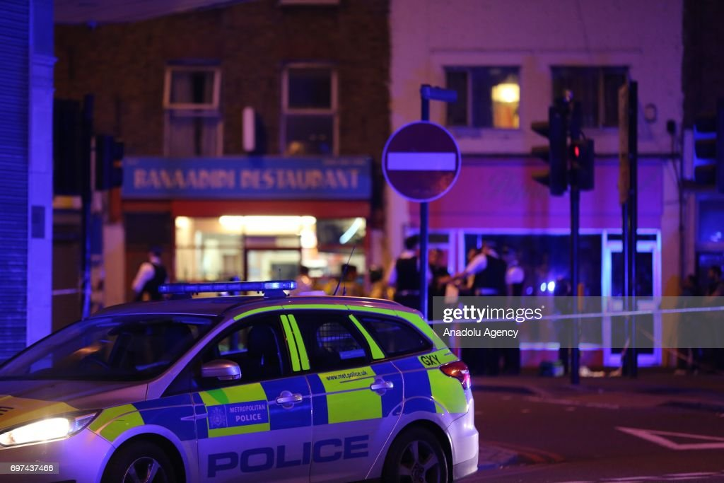 Police take security measures after a vehicle plowed into pedestrians on the sidewalk near the Finsbury Park Mosque on Seven Sisters Road in London, England, United Kingdom on June 19, 2017.