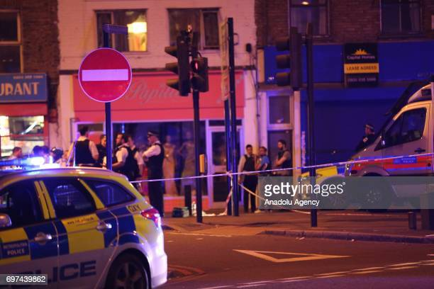 Police take security measures after a vehicle plowed into pedestrians on the sidewalk near the Finsbury Park Mosque on Seven Sisters Road in London...
