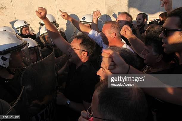 Police take security measures as anti government demonstrators shout slogans during a rally demanding on Greece remain Euro zone at Sintagma Square...