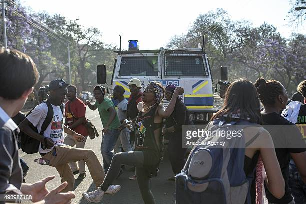 Police take security measures as the students march towards Prime Ministry building during a protest against the increase of tuition fees at South...