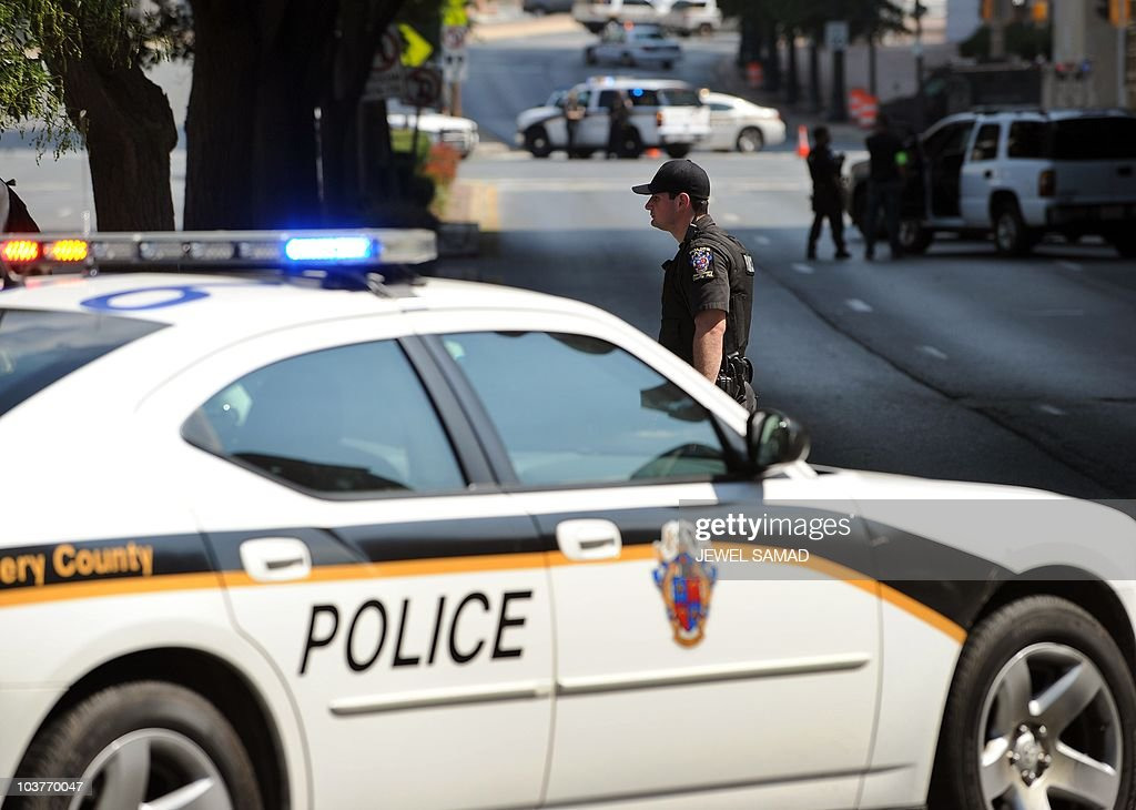 Police take up position in front of the Discovery Channel headquarters in Silver Spring Maryland on September 1 2010 A gunman fired several shots and...