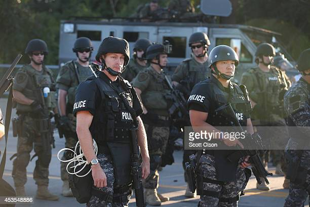 Police take up position to control demonstrators who were protesting the killing of teenager Michael Brown on August 12 2014 in Ferguson Missouri...