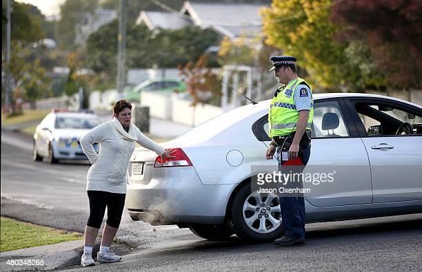 Police talk to residents waiting to return to their homes along Methuen Road New Windsor on March 24 2014 in Auckland New Zealand Many houses in...
